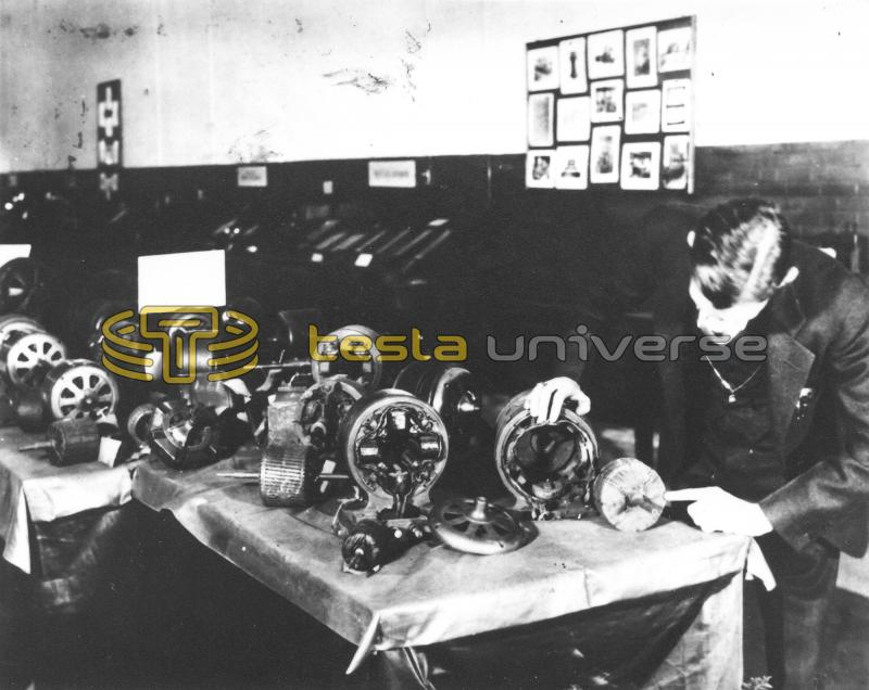 Nikola Tesla with some of his induction motors