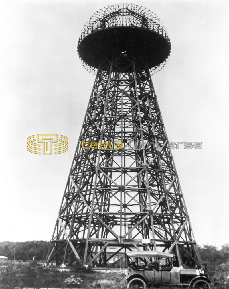 The Tesla Wardenclyffe tower with lab in background and car in foreground