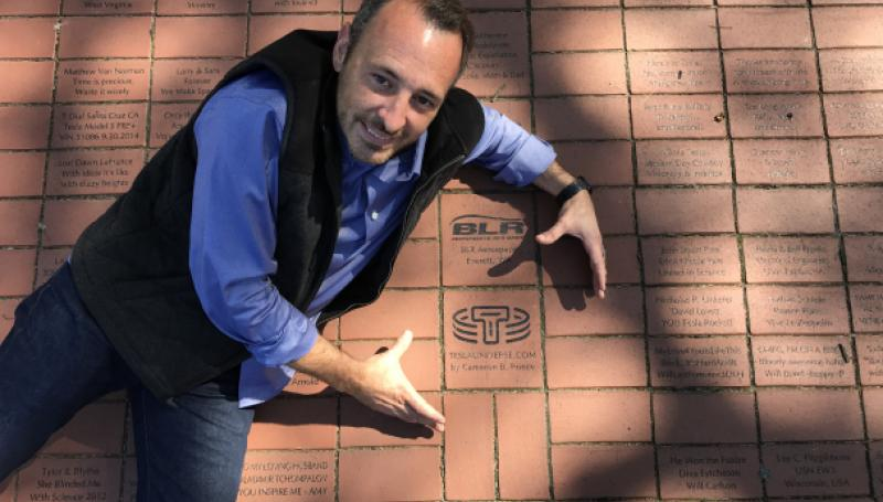 Cameron Prince with Tesla Universe brick at Wardenclyffe