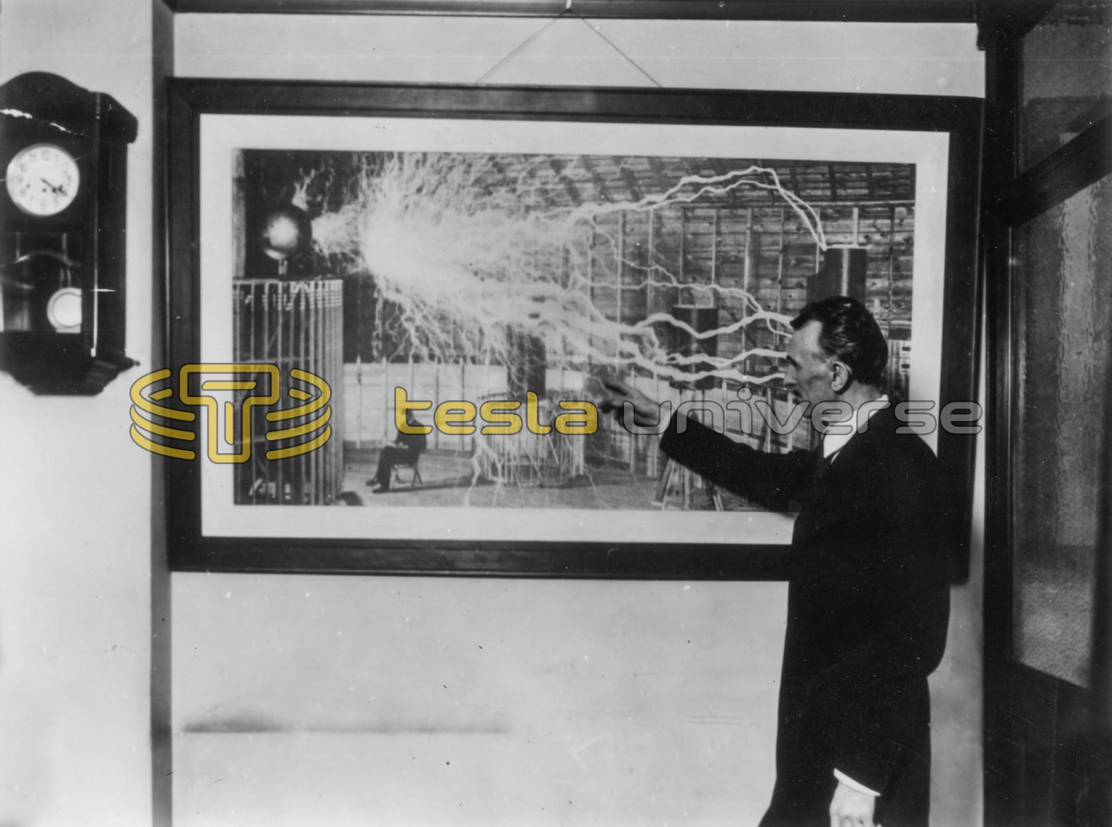 Tesla in 1916 pointing to a discharge in a photograph ...