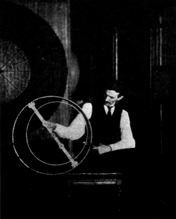 Figure 4 - Tesla working on a resonator coil in his Houston St. lab, 1899.