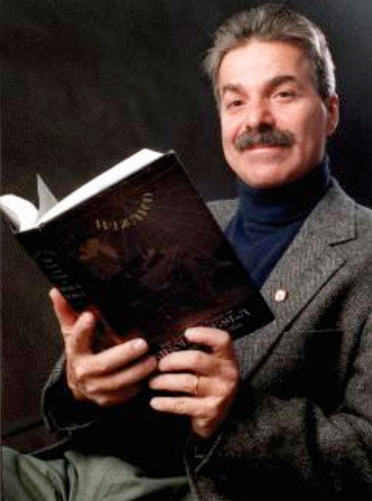 "Marc J. Seifer with his book, ""Wizard""."