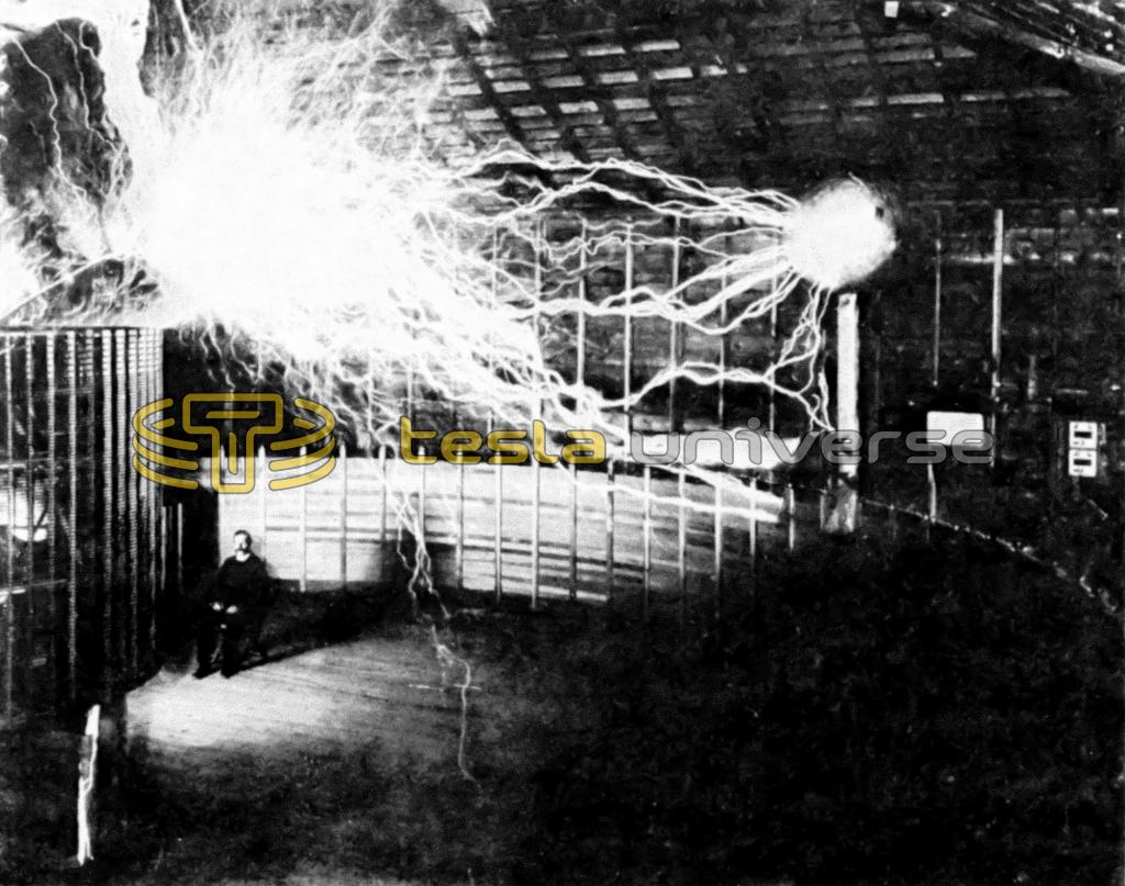 Mr. Alley, Tesla's assistant, poses in a test photo of the Colorado Springs oscillator