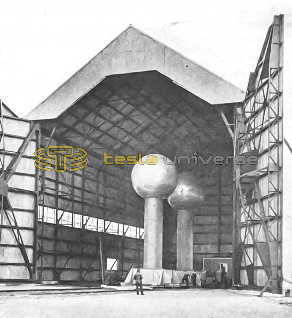 Huge Van de Graaff generator, shown housed in an aircraft hangar