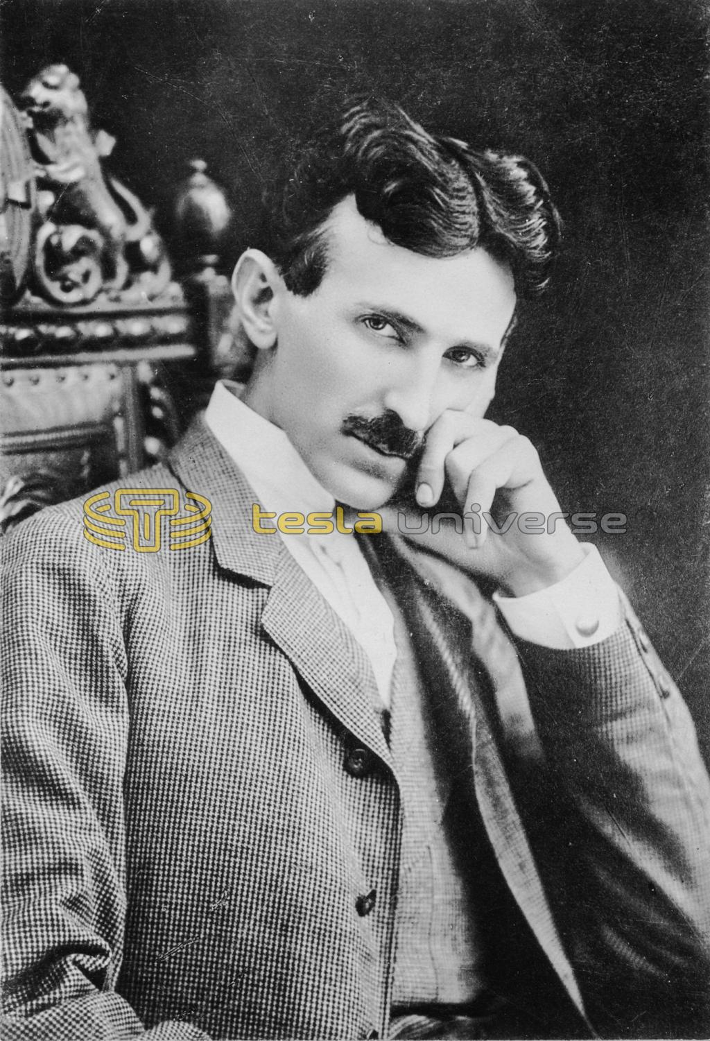 Famous portrait of Nikola Tesla seated in ornamental chair with hand to face
