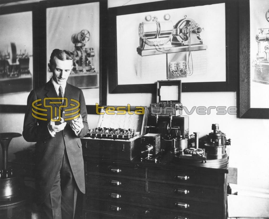 Nikola Tesla in his office in 1916, demonstrating an electrical apparatus