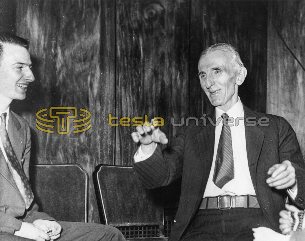 Dr. Nikola Tesla being interviewed by the press