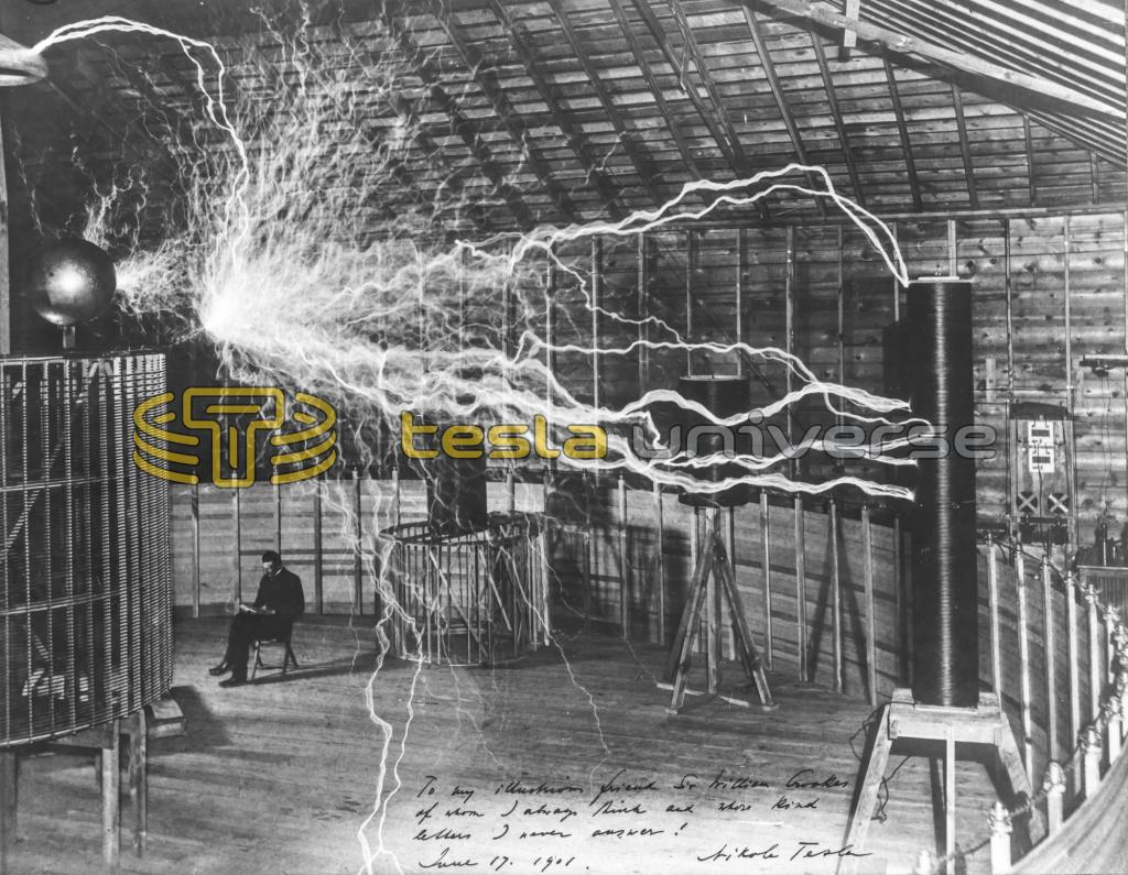 Nikola Tesla seated inside his Colorado Springs oscillator