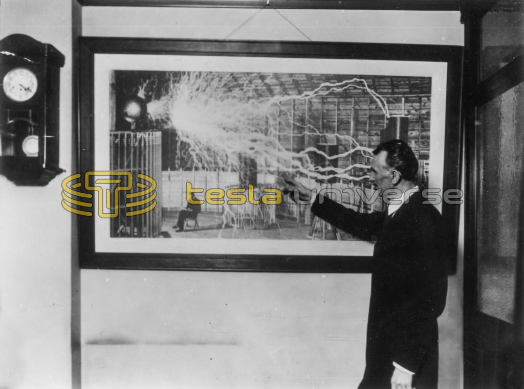 Nikola Tesla pointing to a photograph of his Colorado Springs Experimental Station