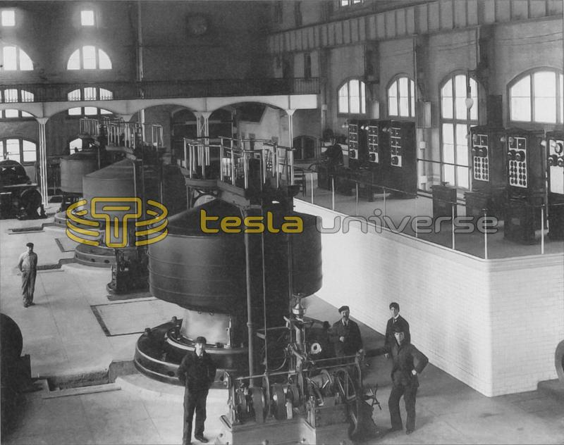 Workers pose near a Westinghouse-Tesla generator in the Edward Dean Adams power station