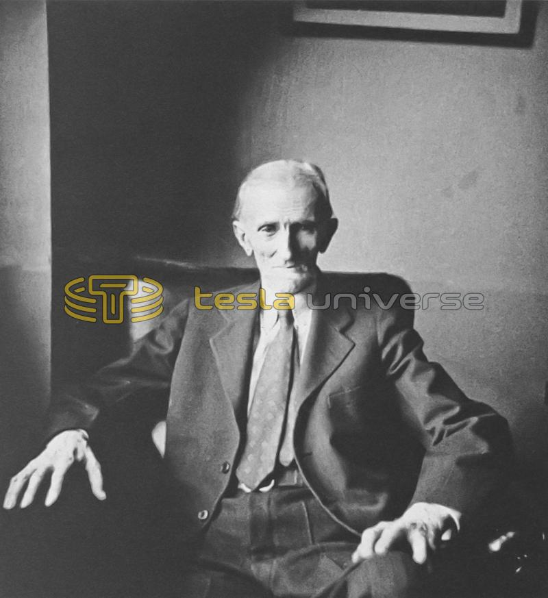Nikola Tesla sitting in a chair in his room at the Hotel New Yorker